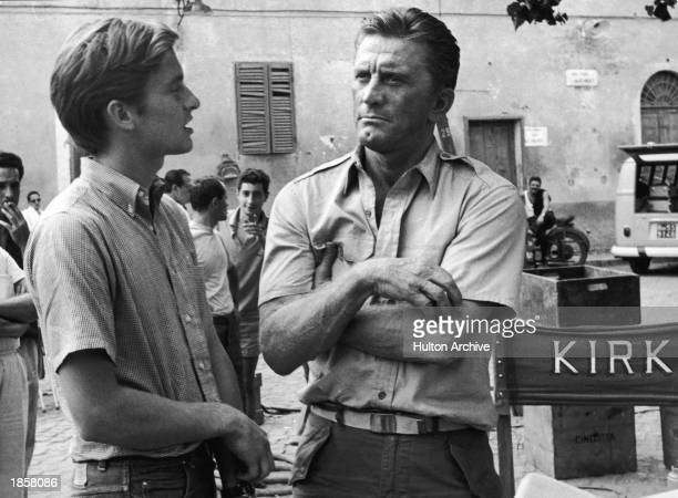 American actor Kirk Douglas and his son American actor Michael Douglas on the set of the film, 'Cast a Giant Shadow,' directed by Melville Shavelson,...