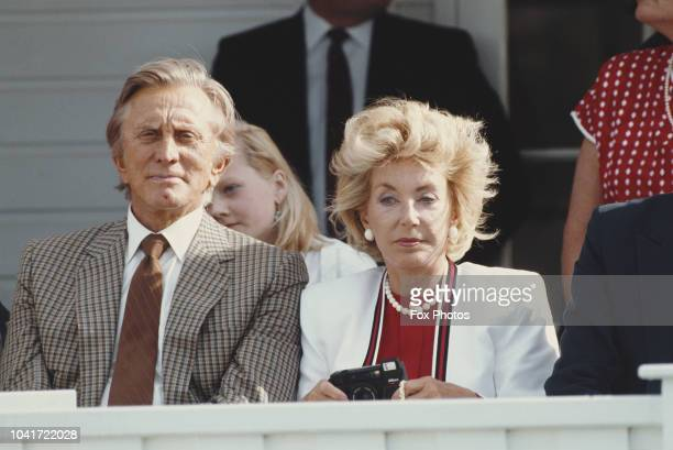 American actor Kirk Douglas and his wife Anne at a polo match UK July 1987