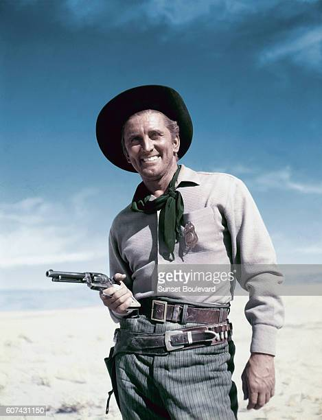 American actor Kirk Douglas on the set of Along the Great Divide directed by Raoul Walsh