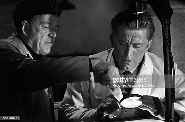 American actor Kirk Douglas preparing a scene with American director Anthony Mann on the set of The Heroes of Telemark. United Kingdom, 10th January...