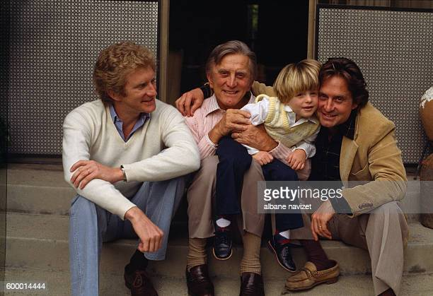 American actor Kirk Douglas relaxes with sons actors Michael Douglas and Peter Douglas and his grandson Cameron