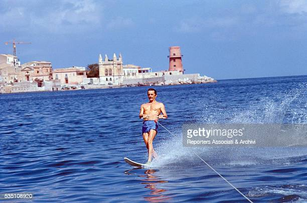 American actor Kirk Douglas waterskiing on the set of The Brotherhood Italy 1968