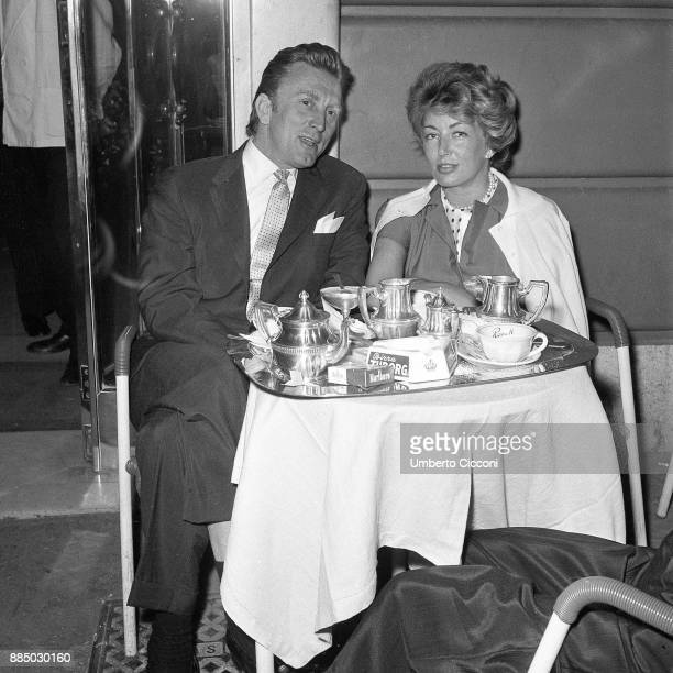 American actor Kirk Douglas with his wife and actress Anne Buydens at the coffee bar in Via Veneto Rome 1958