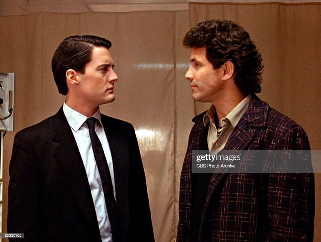 American actor Kyle MacLachlan (as Special Agent Dale Cooper) and Canadian actor Michael Ontkean (as Sheriff Harry S. Truman) stare at one another in a scene from the pilot episode of the television series 'Twin Peaks,' originally broadcast on April 8, 1990.