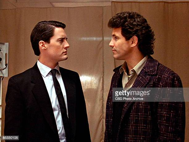American actor Kyle MacLachlan and Canadian actor Michael Ontkean stare at one another in a scene from the pilot episode of the television series...