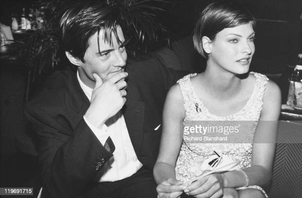 American actor Kyle MacLachlan and his girlfriend Canadian model Linda Evangelista attend a party for the film 'Ed Wood' at the Cannes Film Festival...