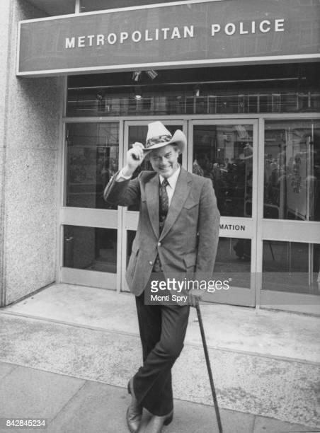 American actor Larry Hagman outside the headquarters of the Metropolitan Police in New Scotland Yard London whilst in character as JR Ewing from the...