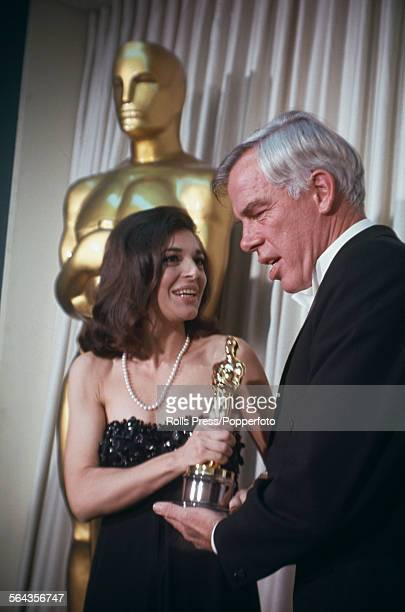 American actor Lee Marvin presents the Academy Award for Best Actress to Anne Bancroft who accepts the Oscar on behalf of absent actress Elizabeth...