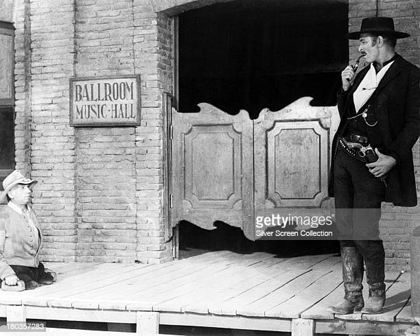 American actor Lee Van Cleef as Angel Eyes and an unidentified actor as the legless informant 'Half Soldier' in 'The Good The Bad And The Ugly'...