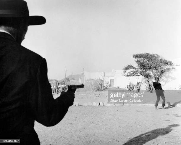 American actor Lee Van Cleef as Colonel Douglas Mortimer and Italian actor Gian Maria Volonte as El Indio in 'For a Few Dollars More' directed by...