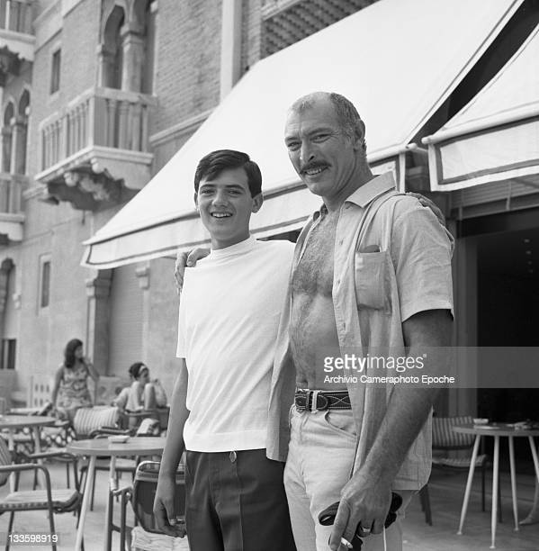 American actor Lee Van Cleef portrayed outside the Excelsior Hotel with a young fan, Lido, Venice, 1967.