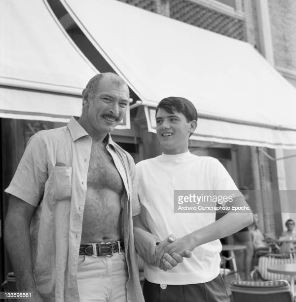 American actor Lee Van Cleef portrayed outside the Excelsior Hotel while shaking a fan's hand Lido Venice 1967