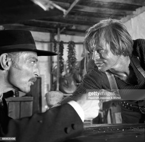 American actor Lee Van Cleef with German actor Klaus Kinski in a scene from the film 'For a Few Dollars More' directed by Sergio Leone 1965