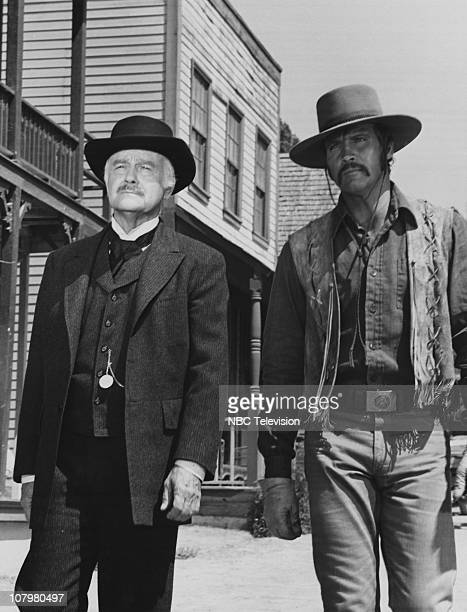 American actor Lew Ayres guest stars with series regular Lee Majors in the NBC television show 'The Men From Shiloh', the final season of 'The...