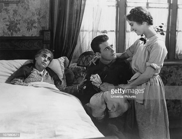 American actor Lew Ayres visits his sick mother played by Beryl Mercer in a scene from the war film 'All Quiet on the Western Front' 1930