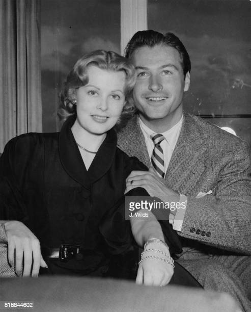 American actor Lex Barker and his wife actress Arlene Dahl during a press reception at the Savoy Hotel in London 22nd May 1951