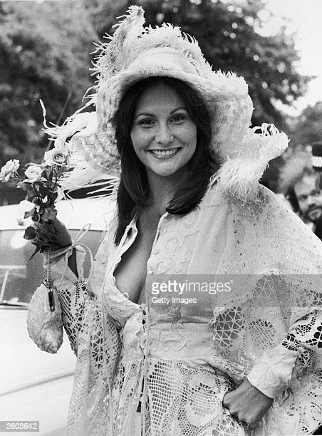 American actor Linda Lovelace poses in a lace outfit while on a film set in England June 19 1974 The star of the pornographic film 'Deep Throat' died...