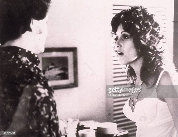 American actor Linda Lovelace talks to an unidentified man in a still from the film 'Deep Throat' directed by Gerard Damiano 1972