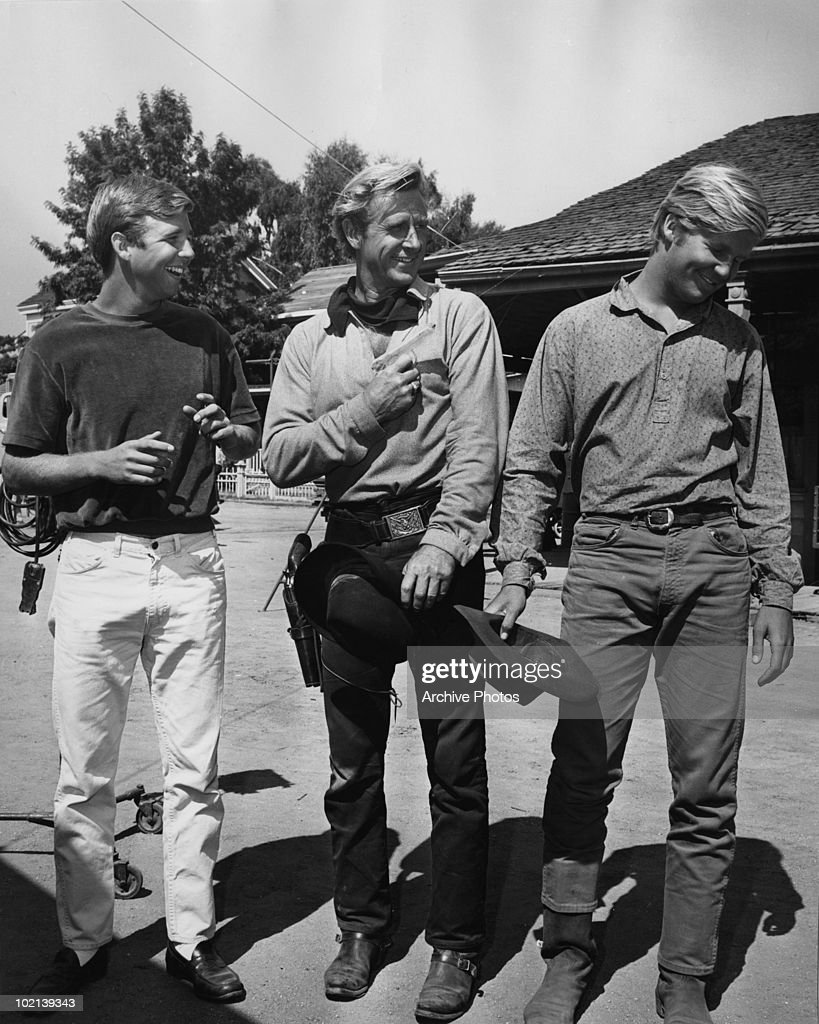 American actor Lloyd Bridges (1913 - 1998) with his sons Beau (left) and Jeff (right) on a western film set, circa 1975.