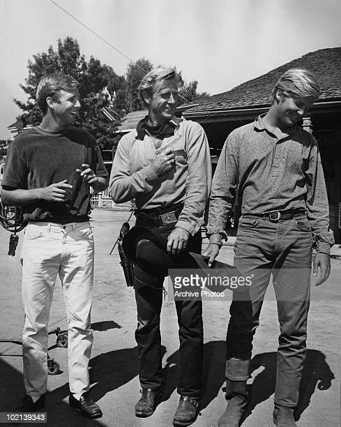 American actor Lloyd Bridges with his sons Beau and Jeff on a western film set circa 1975