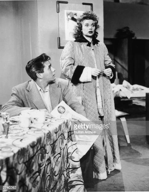 American actor Lucille Ball and Cubanborn actor Desi Arnaz talk to each other in a still from the television series 'I Love Lucy'1956