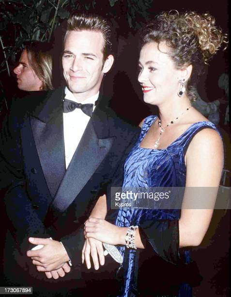 American actor Luke Perry and his partner Minnie Sharp at the 1992 Carousel of Hope Ball Beverly Hilton Hotel Beverly Hills 2nd October 1992