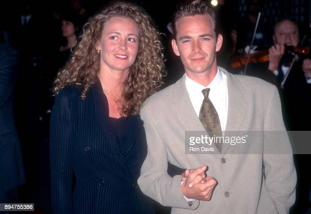 American actor Luke Perry poses for a portrait with his wife Minnie Sharp at the 1995 World Music Awards on May 3 1995 in Monte Carlo Monaco
