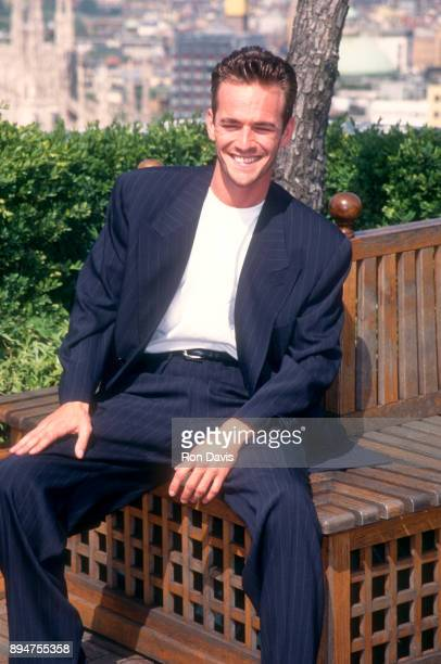 American actor Luke Perry poses while sitting on a rooftop circa 1995