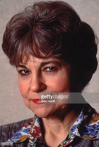 American actor Lynn Cohen smiling in a promotional headshot portrait for director Woody Allen's film 'Manhattan Murder Mystery'
