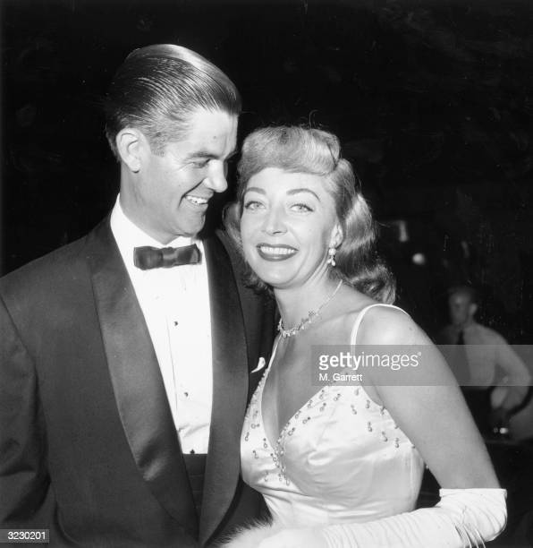 American actor Marie Windsor smiles with her husband Jack Hupps while attending the premiere of director Robert Wise's film 'Executive Suite' at the...