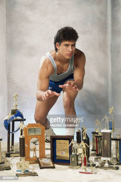 American actor Mario Lopez surrounded by his high school wrestling trophies April 1991 He starred in the popular TV sitcom 'Saved By the Bell'