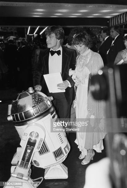 American actor Mark Hamill and his wife Marilou York with R2-D2 attend the royal premiere of 'The Empire Strikes Back' at the Odeon Leicester Square,...