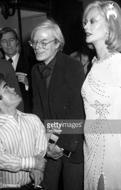 American actor Mark Lawhead speaks with American Pop artist Andy Warhol and Belgianborn actress Belgianborn actress Monique Van Vooren at the...