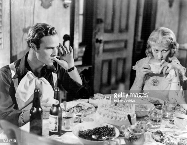 American actor Marlon Brando and British leading lady Vivien Leigh celebrate a tense birthday as Stanley Kowalski and Blanche DuBois in 'A Streetcar...