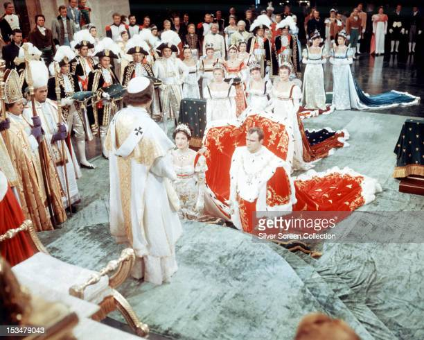 American actor Marlon Brando as Napoleon Bonaparte and Merle Oberon as Josephine in 'Desiree' directed by Henry Koster 1954 In the background centre...