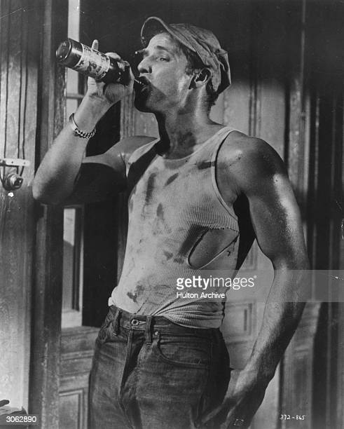 American actor Marlon Brando plays Stanley Kowalski in Tennessee Williams' 'A Streetcar Named Desire'.