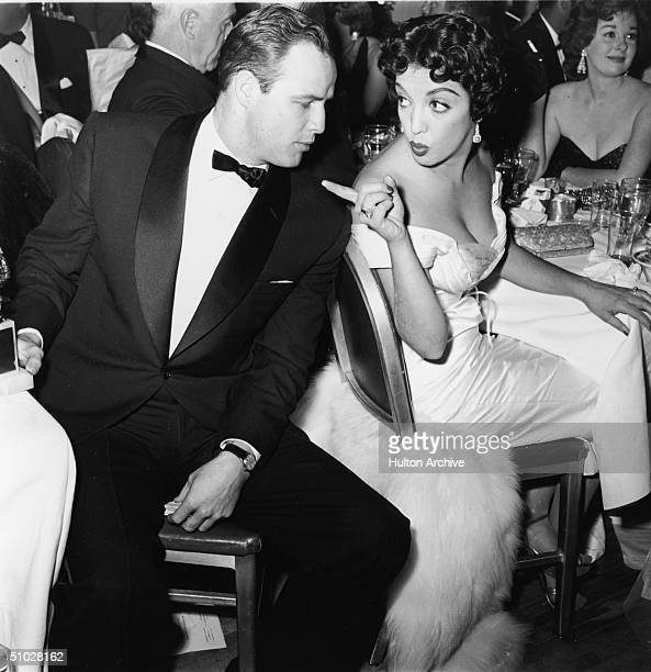 American actor Marlon Brando turns to face Mexican actor Katy Jurado who gestures at him during a formal awards dinner 1950s