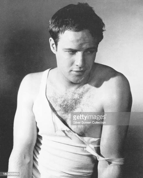 American actor Marlon Brando wearing a torn shirt in a promotional portrait for 'A Streetcar Named Desire' directed by Elia Kazan 1951