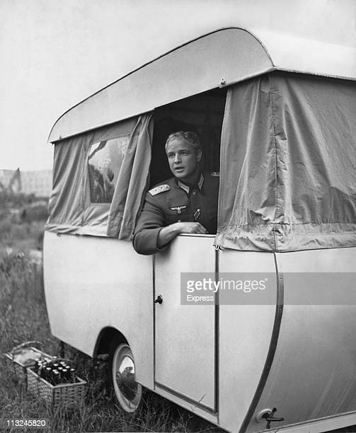 American actor Marlon Brando with dyed blond hair in a caravan on the set of the film 'The Young Lions' in Berlin Germany on August 12 1957