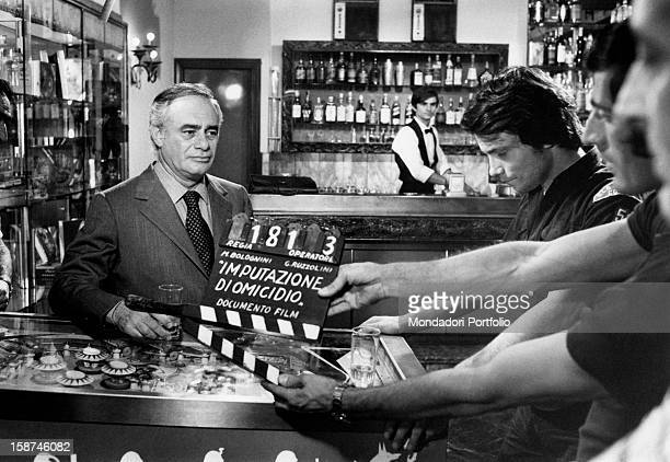 American actor Martin Balsam and Italian singer and actor Massimo Ranieri getting ready for shoot a scene of the film Imputazione di omicidio per uno...