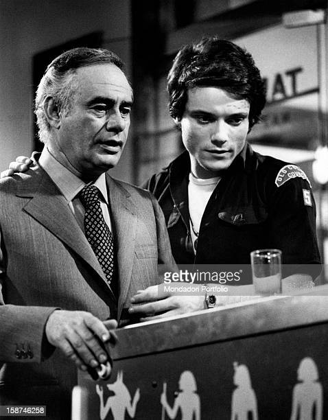 American actor Martin Balsam and Italian singer and actor Massimo Ranieri playing pinball machine in the film Imputazione di omicidio per uno...