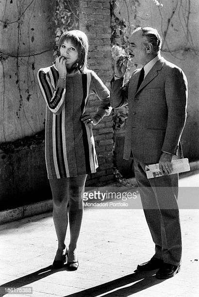 American actor Martin Balsam smoking a cigarette beside Italian actress Paola Pitagora on the film set of The True and the False Rome 1972