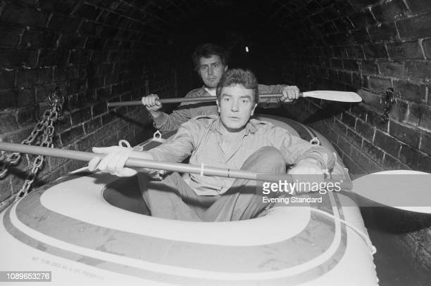 American actor Martin Sheen and British actor Albert Finney on an inflatable boat filming heist movie 'Loophole' UK 16th July 1980