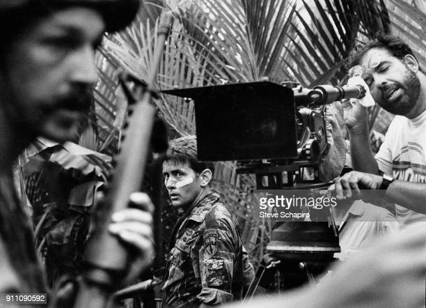 American actor Martin Sheen glances over his shoulder as director Francis Ford Coppola looks through a camera on the set of their film 'Apocalypse...