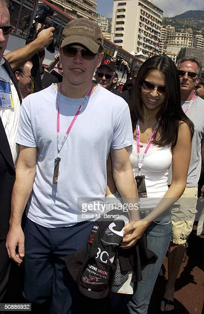 American actor Matt Damon and girlfriend Luciana Bozan attend the 'Oceans 12' photocall in the Pits as the official guests of the Jaguar racing team...