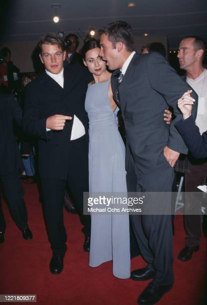 American actor Matt Damon, British actress Minnie Driver, and American actor Ben Affleck attend the premiere of 'Good Will Hunting' at the Mann Bruin...