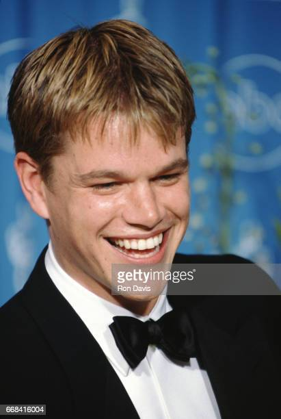 """American actor Matt Damon smiles after winning his Oscar for """"Good Will Hunting"""" during the 70th Annual Academy Awards on March 23, 1998 at the..."""