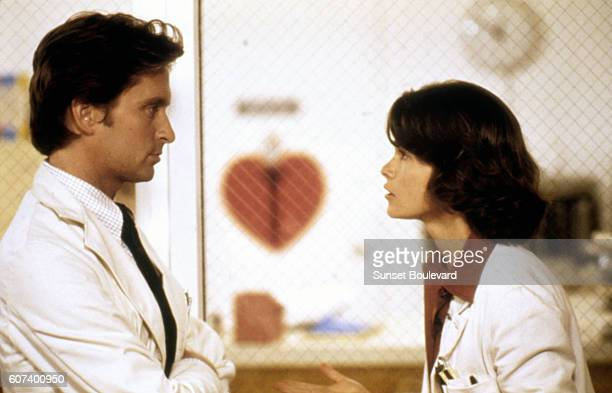 American actor Michael Douglas and Canadian actress Genevieve Bujold on the set of Coma written and directed by American Michael Crichton