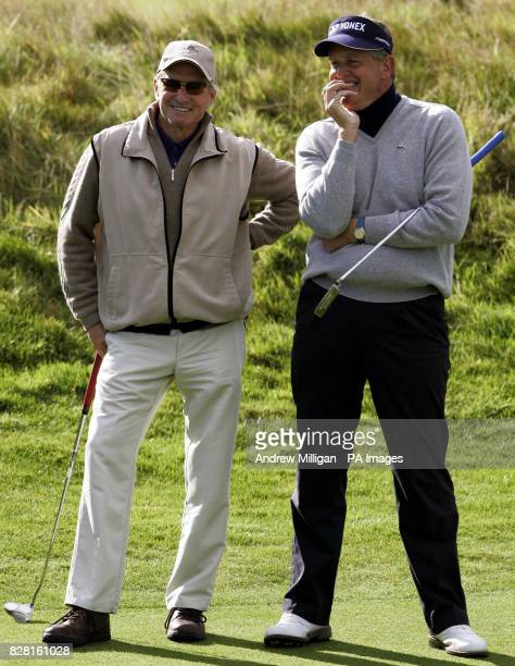 American Actor Michael Douglas and Scotland's Colin Montgomerie on the 12th green during round one of the Dunhill Links Championships at Carnoustie...
