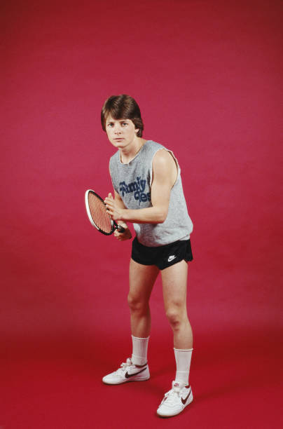 American actor Michael J. Fox poses with a tennis racket and a  Family Ties f03179a736db
